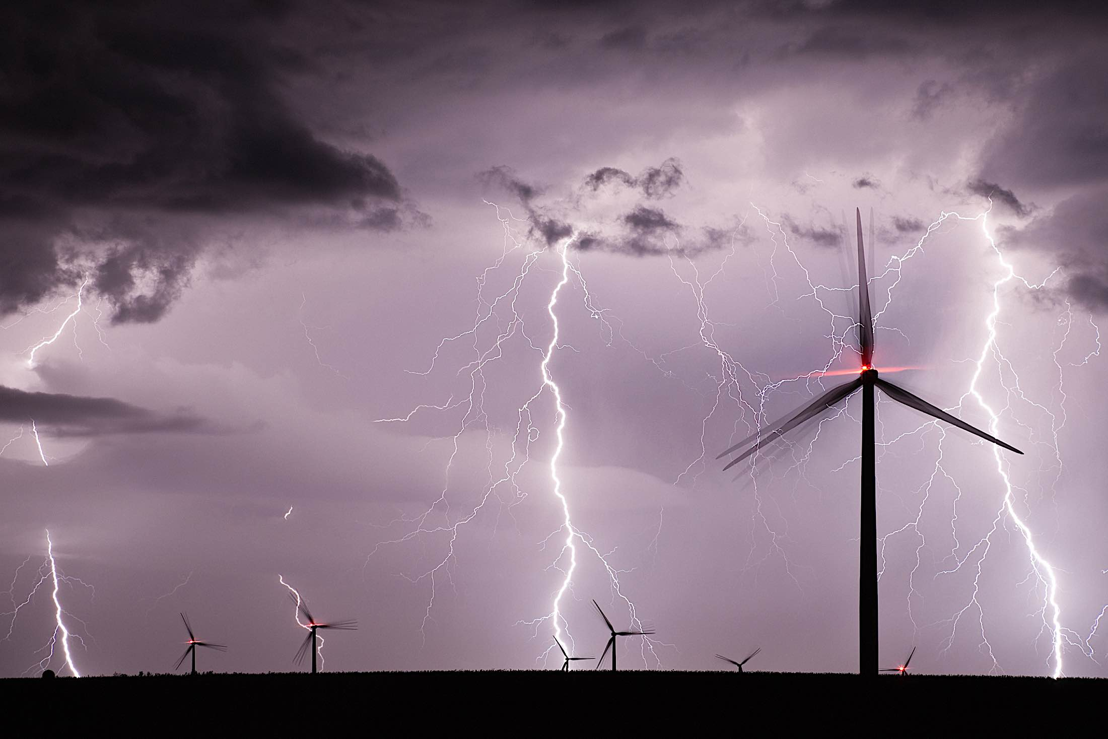 Engineered Design Insider THundrestorm at a wind farm at nightOil Gas Automotive Aerospace Industry Magazine
